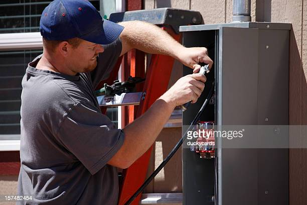 electrician working on electrical service panel - electrical panel box stock pictures, royalty-free photos & images