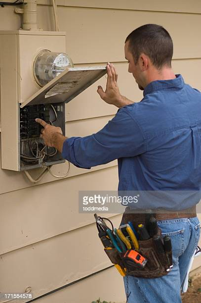 Electrician working on power box