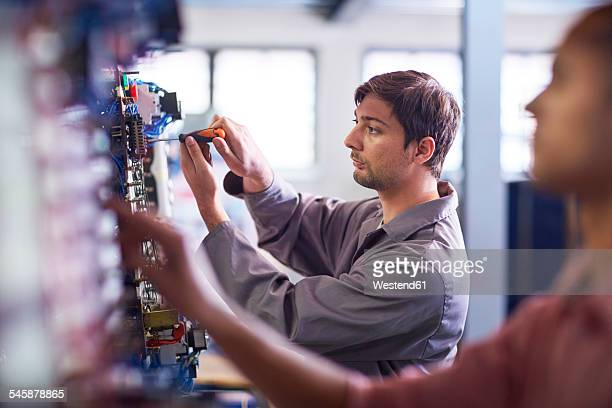 Electrician working with screw driver