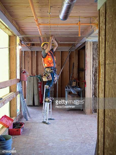 Electrician works in new construction