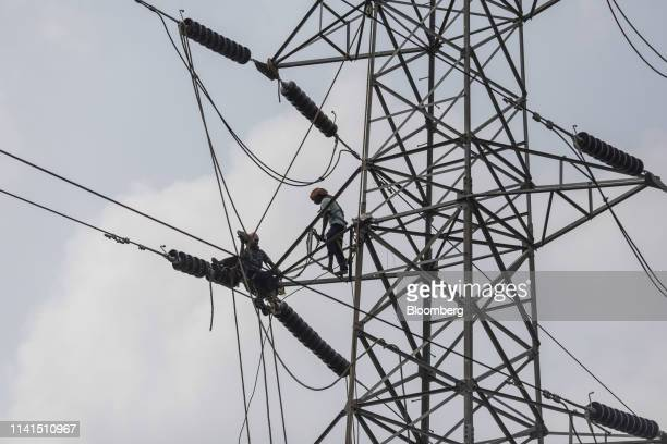 Electricians repair a transmission tower in Bhubneshwar Odisha India on Sunday May 5 2019 Authorities launched a massive restorationandrelief effort...