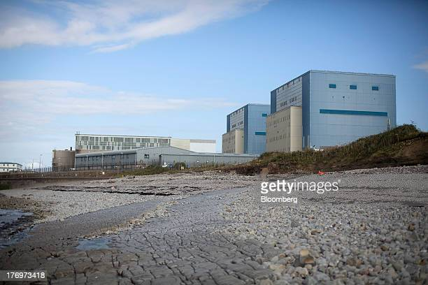 Electricite de France SA's Hinkley Point A nuclear power station right stands on the bank of the Bristol Channel near Bridgwater UK on Monday Aug 19...