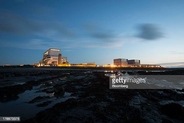 Electricite de France SA's Hinkley Point B left and A nuclear power stations stand on the bank of the Bristol Channel near Bridgwater UK on Monday...