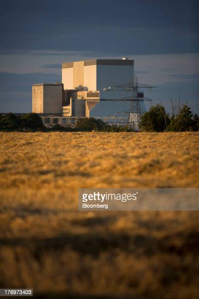 Electricite de France SA's Hinkley Point B nuclear power station stands beyond farmer's fields near Bridgwater UK on Monday Aug 19 2013 EDF's plans...