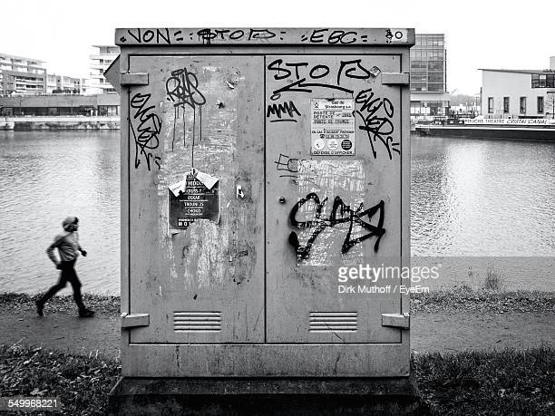 electricity box by river in city - electrical box stock pictures, royalty-free photos & images
