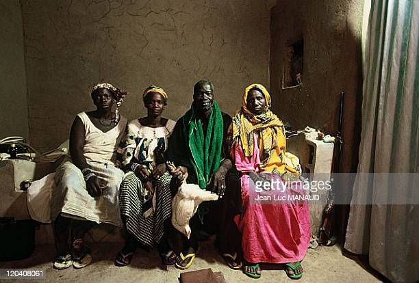 Electricity in Konseguela Mali Mr Drissa Kone and his wives in Konseguela