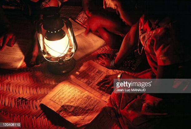 Electricity in Mali Doing homework using the light of an oil lamp