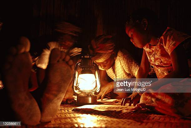 Electricity in Mali on September 12 1973 Doing school homework by oil lamplight
