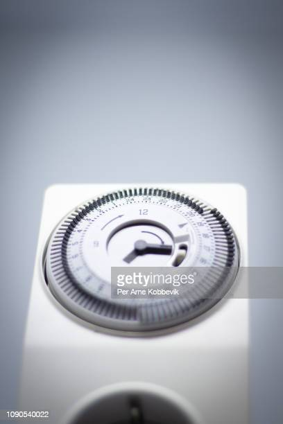 electricity manual timer for a wall socket - for stock pictures, royalty-free photos & images