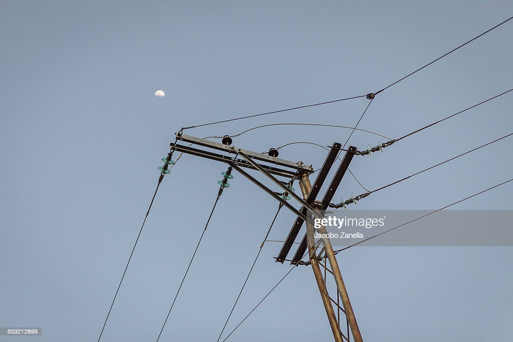 Electricity Pole With The Moon In The Distance Stock Photo   Getty