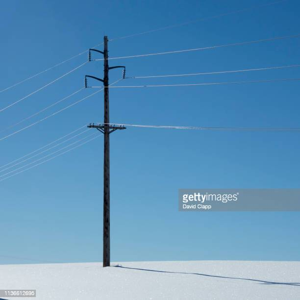 electricity pylon in the snow  in idaho, united states of america - tower stock pictures, royalty-free photos & images