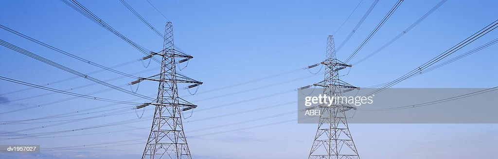 Electricity Pylons Against a Blue Sky : Stock Photo