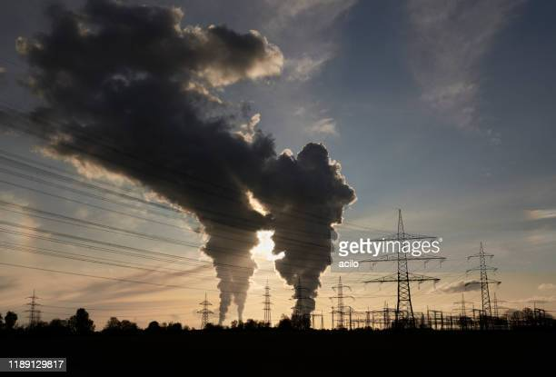 electricity pylons and two coal fired power plants with pollution - coal fired power station stock pictures, royalty-free photos & images