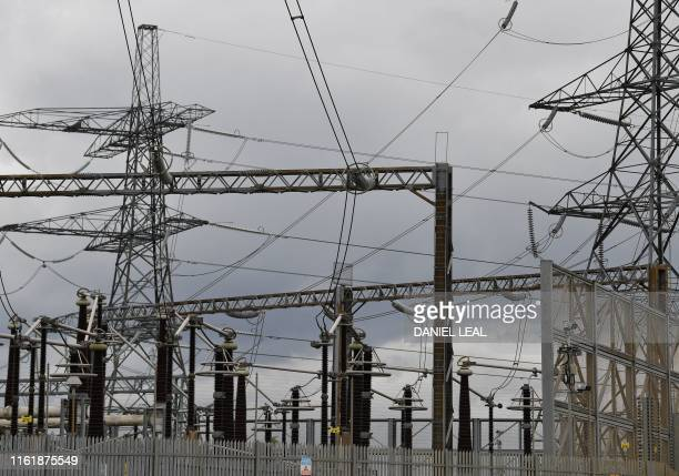 Electricity pylons are seen at the National Grid Barking Substation in east London on August 16 2019 National Grid which runs Britain's power network...