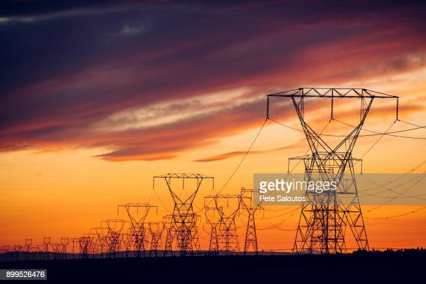 Electricity pylons at sunset, Enterprise, Oregon, United States, North America