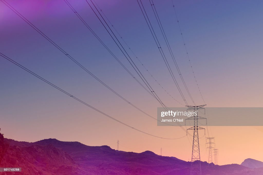 Electricity pylons at sunset : Foto de stock