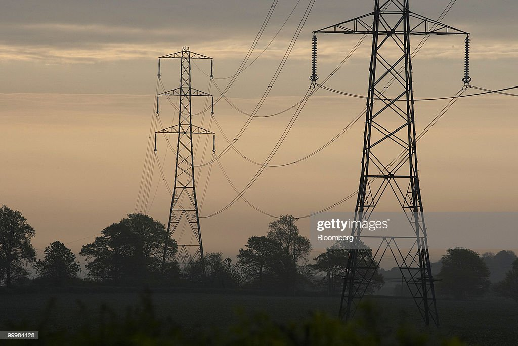Electricity pylons carry high voltage power lines in Hampshire, U.K., on Wednesday, May 19, 2010. Electricity use may have peaked today at 45,030 megawatts, reducing the cushion of spare capacity available to the network to 7,466 megawatts, according to data from National Grid Plc. Photographer: Rupert Hartley/Bloomberg via Getty Images