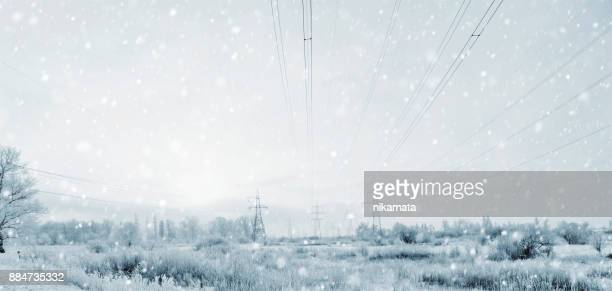 Electricity Pylons in the Winter Storm with a Blizzard