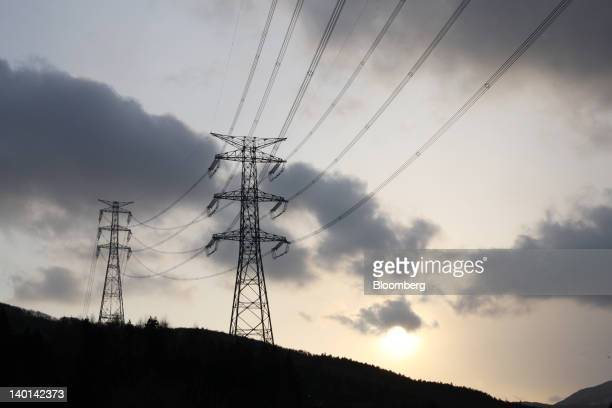Electricity pylons leading from Tokyo Electric Power Co's Fukushima DaiIchi nuclear power station stand in Kawauchi Village Fukushima Prefecture...