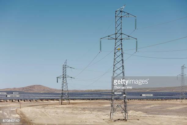 Electricity pylons on a solar field Planta Solar Cerro Dominador on October 17 2017 in Atacama Desert Chile