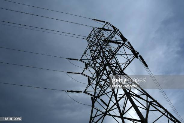 electricity pylons - communications tower stock pictures, royalty-free photos & images