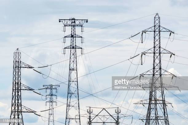 Electricity pylons silhouetted against the sky on June 9 2019 in Newport United Kingdom