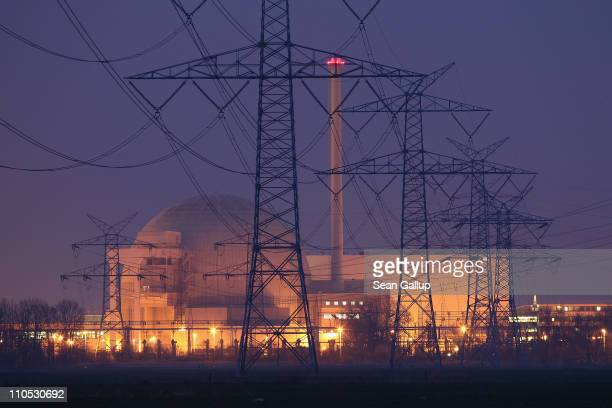Electricity pylons stand in a row leading to the Unterweser nuclear power plant on March 21 2011 near Stadland Germany The Unterweser plant is among...