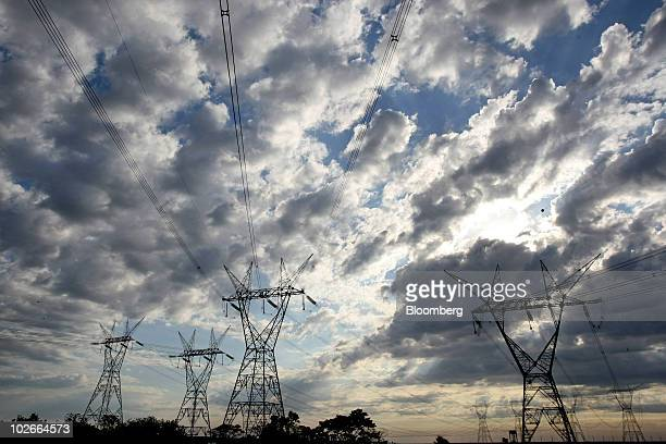 Electricity pylons stand next to the Itaipu Reservoir site of the Itaipu hydroelectric power plant along the Parana River in Foz do Iguacu Brazil on...
