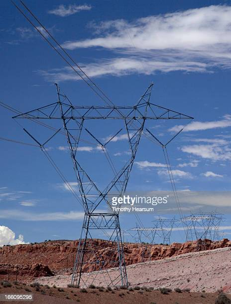 electricity pylons with red mesas, clouds and sky - timothy hearsum stock pictures, royalty-free photos & images