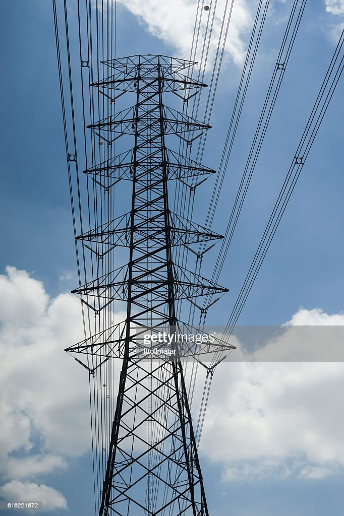 electricity transmission lines and pylon : Stock Photo