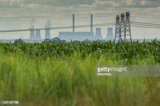 Electricity transmission pylons near the Komati coal-fired power station, operated by Eskom Holdings SOC Ltd., in Mpumalanga, South Africa, on...