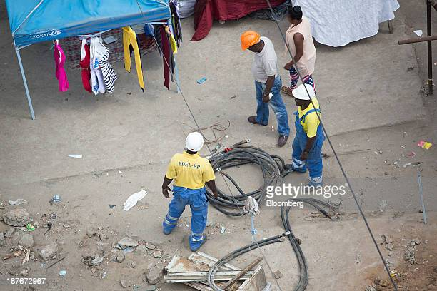 Electricity workers for Empresa de Distribuicao de Energia Electrica lay cables in Luanda Angola on Friday Nov 8 2013 Angola the largest crude oil...