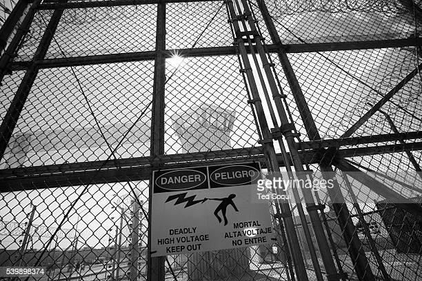Electrified fencing and guard tower of the California State Prison in Los Angeles County. California prison officials, grappling with severe...