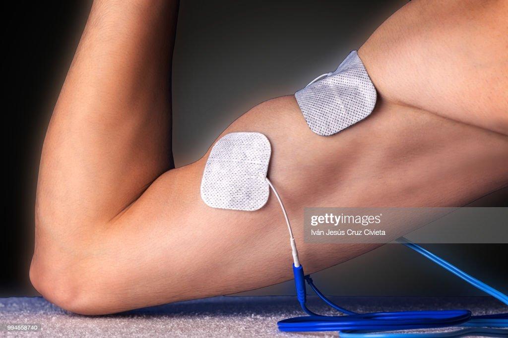 Electro stimulation biceps : Stock Photo