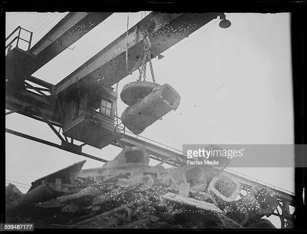 Electromagnetic crane lifting pieces of metal at the Newcastle Steelworks New South Wales 16 June 1933 [picture] [nlapicvn6217320]
