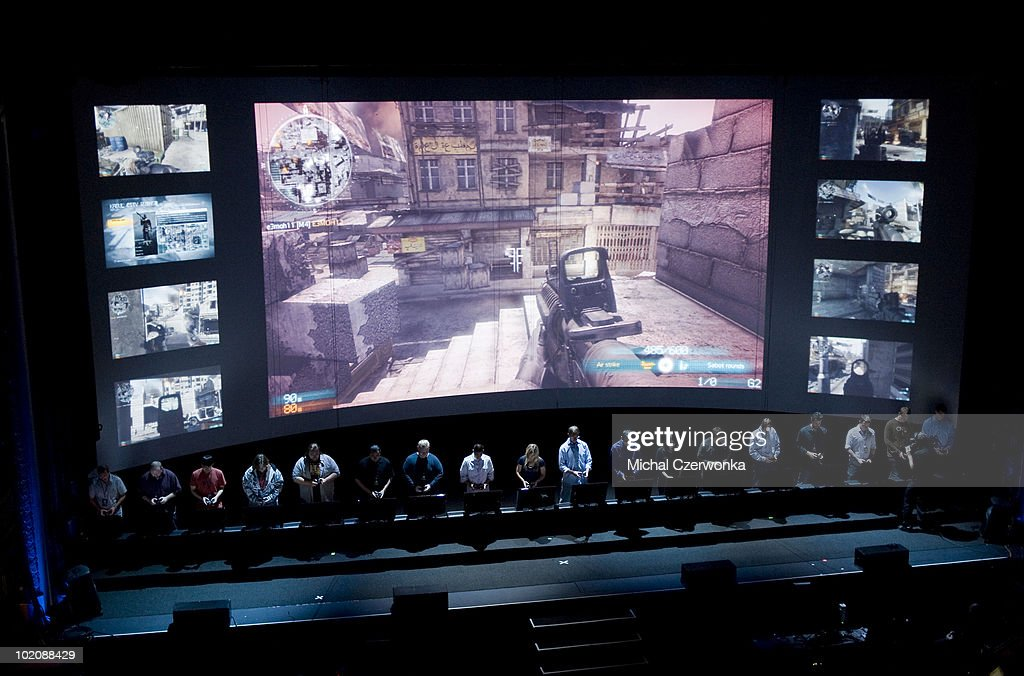 Electronic Arts (EA) employee's demonstrate game play in the new 'Medal of Honor' game at an EA press briefing ahead of the Electronic Entertainment Expo (E3) at the Orpheum Theater June 14, 2010 in Los Angeles, California. The annual video game trade conference and show at the Los Angeles Convention center runs June 15-17.