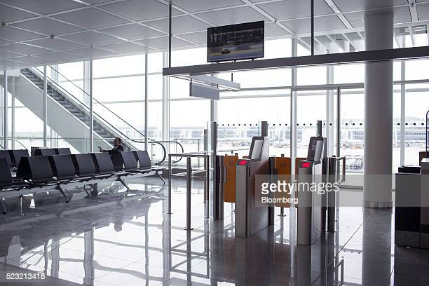Electronic boarding gates sit at an aircraft boarding point operated by Deutsche Lufthansa AG at Munich Airport's Terminal 2 during the official...