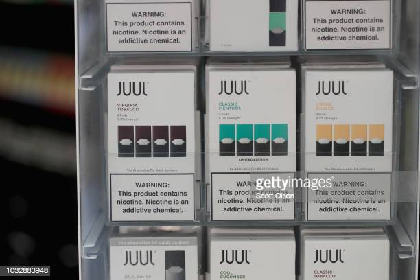 Electronic cigarettes and pods by Juul the nation's largest maker of vaping products are offered for sale at the Smoke Depot on September 13 2018 in...