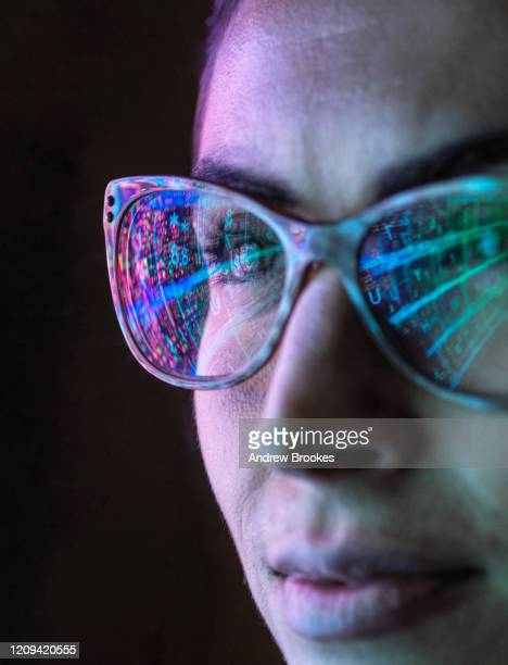 electronic circuit board on computer monitor reflecting in glasses of a female engineer. - data stock pictures, royalty-free photos & images