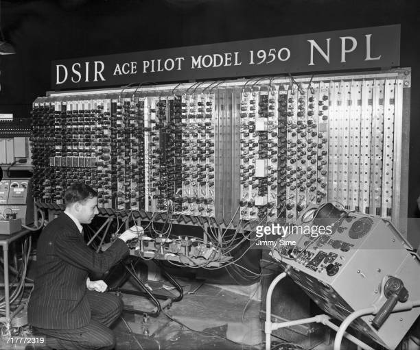 Electronic engineer Edward Newman inspects the mercury delay lines which form the memory of Pilot Model ACE the prototype of the Automatic Computing...