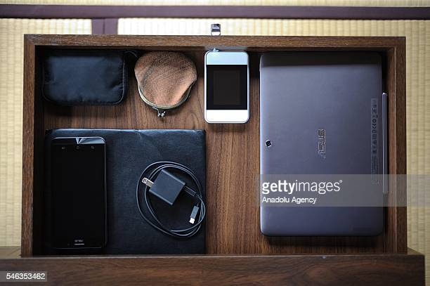 Electronic items are seen on the table of minimalist Katsuya Toyodas homei in Fujisawa Kanagawa Prefecture in the southern of Tokyo Japan on June 29...