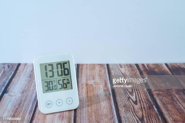 electronic lcd digital clock humidity temperature sensor display device - digital thermometer ストックフォトと画像