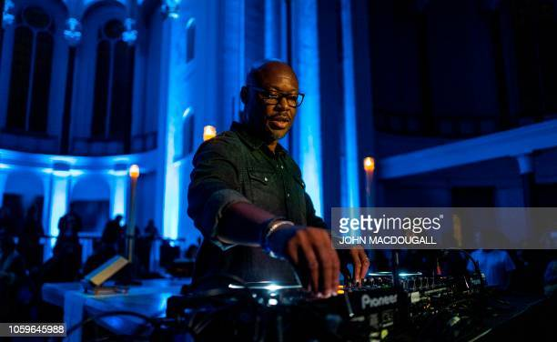 US electronic music producer DJ and pastor Robert Hood spins some tunes during a Techno Mass in the Saint Thomas church in Berlin on November 9 2018...