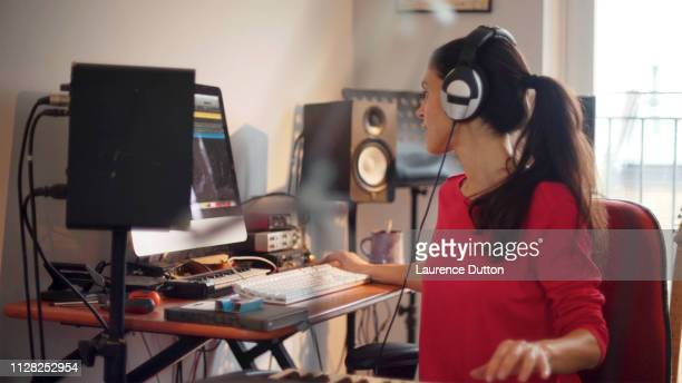electronic music woman - equaliser stock pictures, royalty-free photos & images