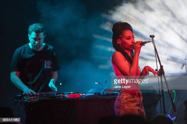 Electronic musician George FitzGerald and a singer of his live band perform live on stage during a concert at Schwuz on March 20 2018 in Berlin...