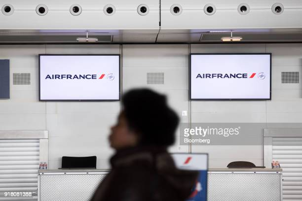 Electronic screens above the checkin desks display the Air FranceKLM Group company logo at Charles de Gaulle airport operated by Aeroports de Paris...