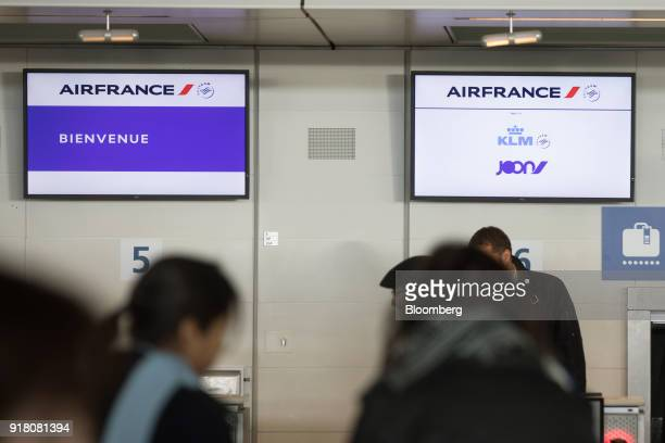 Electronic screens at the bagdrop area display the company logos of Air FranceKLM Group and Joon at Charles de Gaulle airport operated by Aeroports...