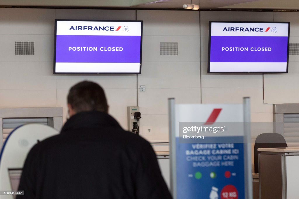 Electronic screens display 'position closed' above the Air France-KLM Group check-in area at Charles de Gaulle airport, operated by Aeroports de Paris, in Paris, France, on Monday, Feb. 12, 2018. Air France will report its full year earnings on Feb 16. Photographer: Christoph Morin/Bloomberg via Getty Images