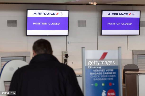 Electronic screens display 'position closed' above the Air FranceKLM Group checkin area at Charles de Gaulle airport operated by Aeroports de Paris...