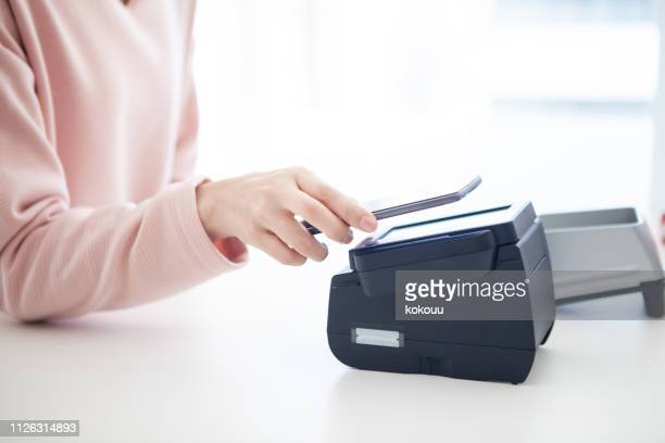electronic settlement by smartphone - wages stock photos and pictures